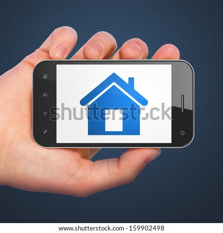Finance concept: hand holding smartphone with Home on display. Mobile smart phone in hand on Blue background, 3d render