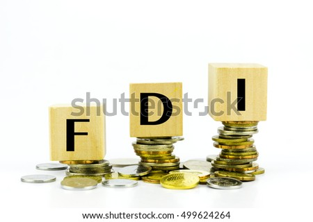 Finance Concept with Stack of Coins - FDI (Foreign Direct Investment) written on.