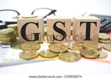 Finance Concept with Stack of Coins, GST or Good and Services Tax written