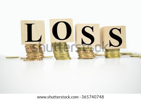 Finance Concept with Stack of Coins, with loss written