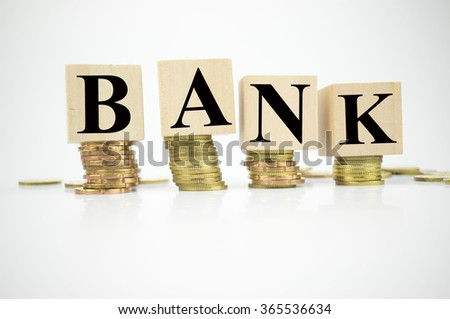 Finance Concept with Stack of Coins, with word Bank written
