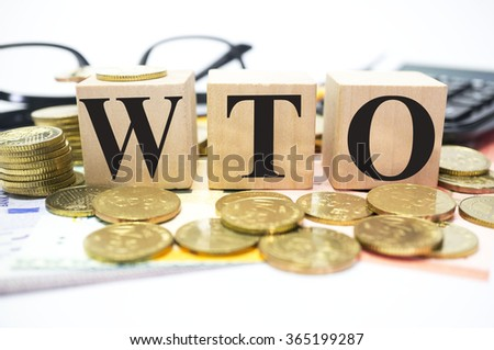 Finance Concept with Stack of Coins, WTO or World Trade Organization written