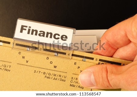 finance on business office folder showing financial success concept