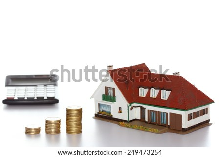finance symbol with house and money coins - stock photo