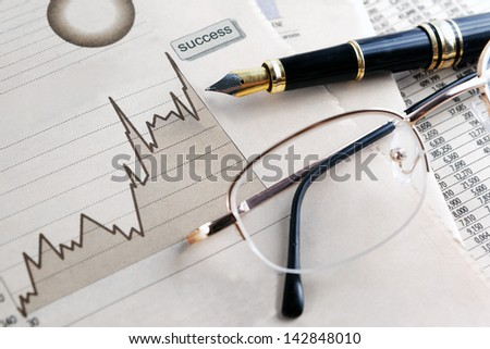 finances and economical background.Statistic, graphics and glasses - stock photo