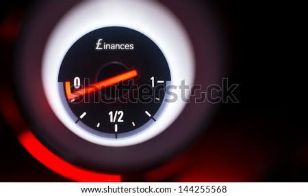 Finances fuel gauge at empty. - stock photo