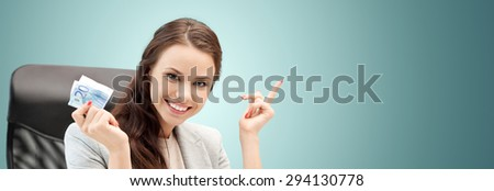 finances, people, savings and investment concept - happy business woman with euro cash money over blue background - stock photo