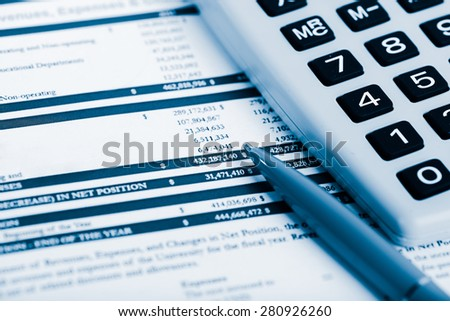Financial accounting.  Blue toned - stock photo