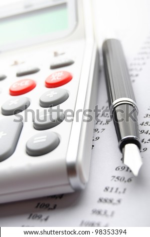 financial accounting concept with white calculator in office - stock photo