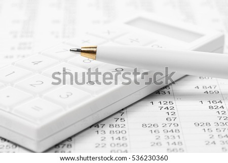 Financial accounting  Pen on calculator
