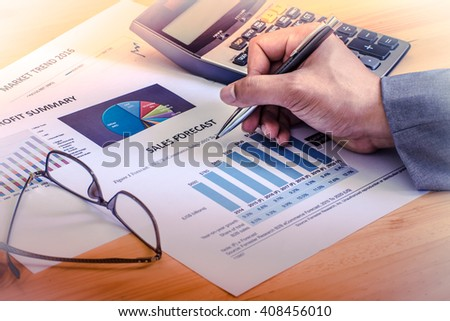 Financial accounting sales forecast graphs analysis with hand writing , digital effect abstract for background - stock photo