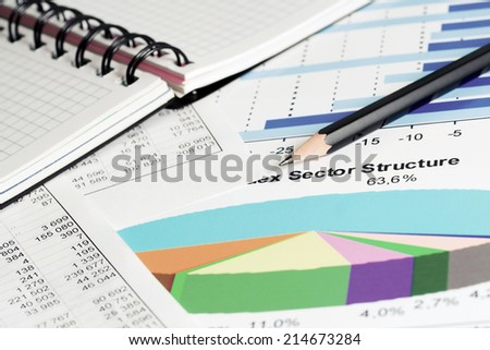 Financial accounting stock market graphs and charts analysis  - stock photo