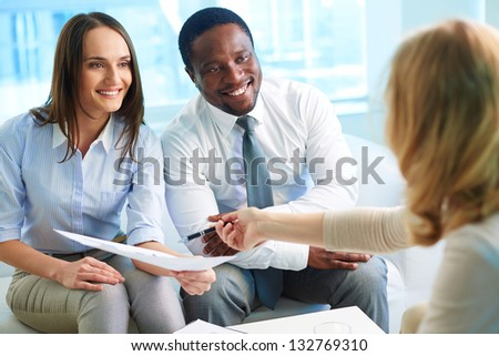Financial adviser explaining how to improve the results of the work - stock photo