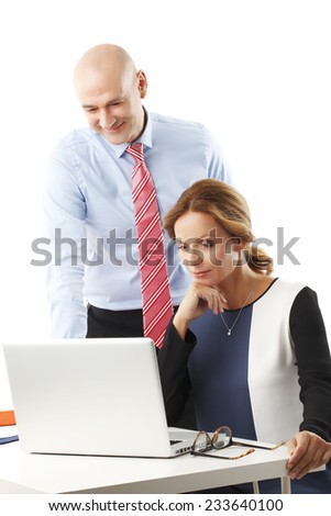 Financial adviser giving advise to business woman and working on laptop. Isolated on white background. - stock photo