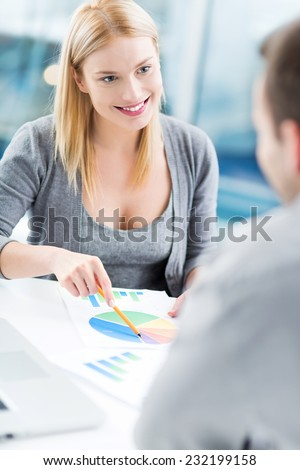 Financial adviser with a client  - stock photo
