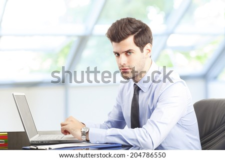 Financial adviser working on laptop. Business people.