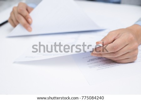Financial advisor viewing legal documents
