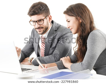 Financial advisors analyzing data on laptop while sitting at desk against white background. - stock photo