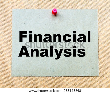 Financial Analysis written on paper note pinned with red thumbtack on wooden board. Business conceptual Image - stock photo
