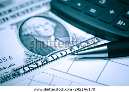 Financial background. Closeup of one dollar notes near calculator - stock photo