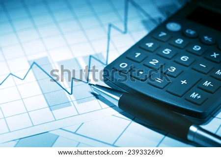 Financial background. Closeup of pen near calculator on paper with chart - stock photo