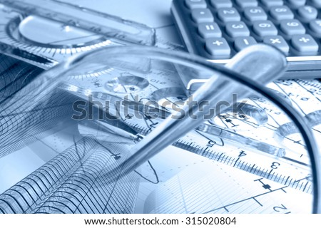 Financial background in blues with glasses, calculator, graph and buildings. - stock photo