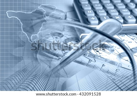 Financial background in blues with graph, calculator, map and pen. - stock photo