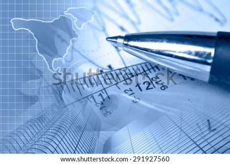 Financial background in blues with map, buildings, graph and pen. - stock photo
