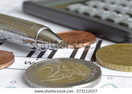 Financial background with money, calculator, graph and pen.