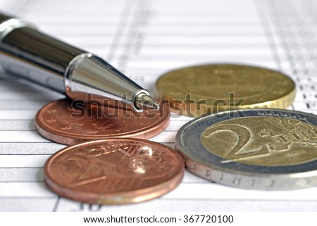 Financial background with money, table and pen.