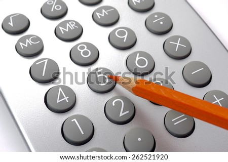 Financial business calculation with calculator and red pencil - stock photo