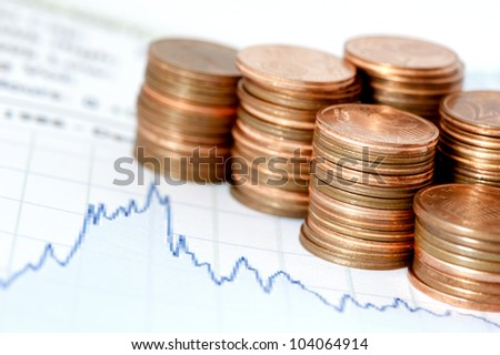 Financial chart and coins - stock photo