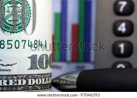 Financial Chart, Calculator and US Currency One Hundred Dollar Bills. - stock photo