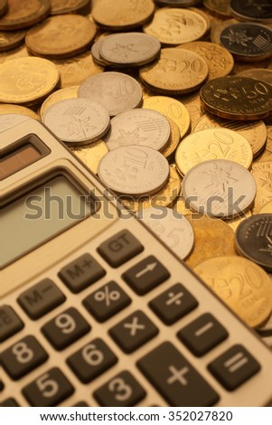 Financial. Close up calculator and coins of Malaysia.