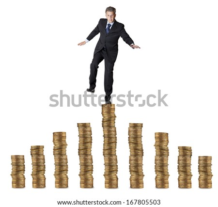 Financial concept. businessman standing on the coins
