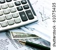 Financial concept. Calculator and pen.  shallow DOF. - stock photo