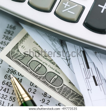 Financial concept. Calculator and pen.  shallow DOF.