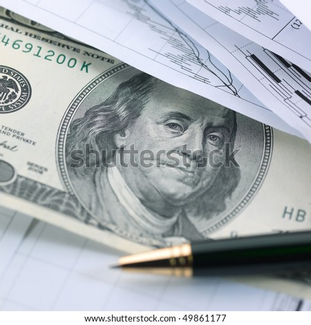Financial concept. Charts, money and pen.  shallow DOF.