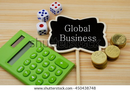 Financial concept-  Global business (Calculator,coins,dice on wooden background) - stock photo
