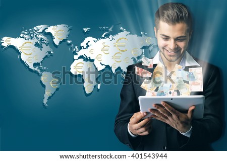 Financial concept. Make money on the Internet. Handsome businessman holding tablet on world map background - stock photo