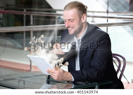 Financial concept. Make money on the Internet. Young attractive businessman having lunch and working in a cafe - stock photo