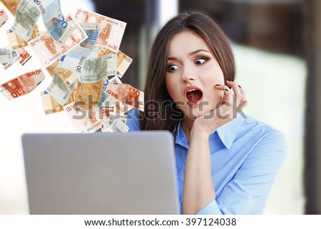 Financial concept. Make money on the Internet. Young woman working with laptop in the office - stock photo