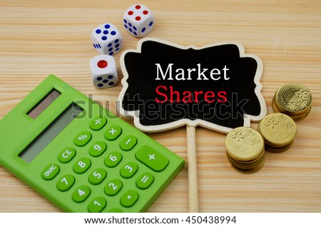 Financial concept-  Market shares (Calculator,coins,dice on wooden background) - stock photo