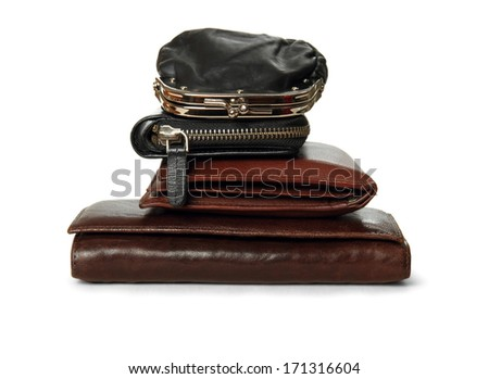 Financial concept of balanced wallets tower, isolated - stock photo