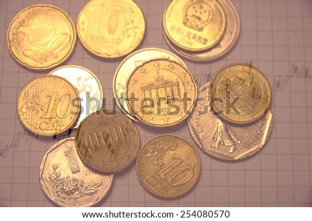Financial concept. Stock chart & world coins. - stock photo