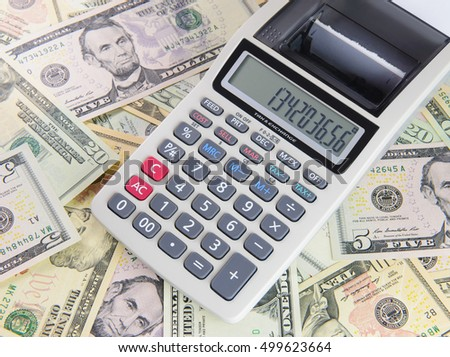 Financial concept with calculator and dollars background