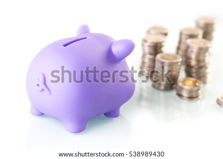 Financial concept with piggy bank, pile of money on white background