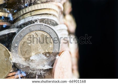 Financial concepts - 'frozen assets' , 'budget freeze', or 'cold hard cash' - stock photo