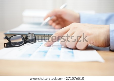 financial consultant is reviewing investment portfolio - stock photo