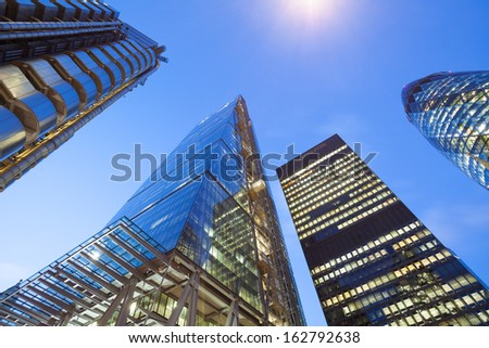 Financial Corporate building Skyscrapers in the Canary Wharf at night, City of London  - stock photo